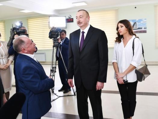 Алиевы на открытии жилого комплекса для беженцев