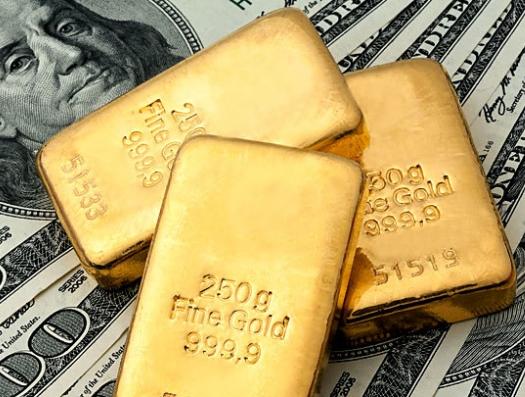 Доллар пошел вниз, а цена на золото бьет рекорд