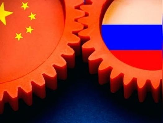 Юань и рубль объединились против доллара
