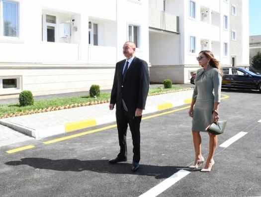Алиевы на открытии общежития в Баку